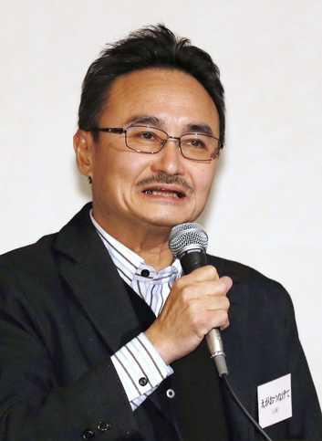 活動報告する「えがおつなげて」の曽根原久司代表理事