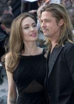 2013年6月、英ロンドンの映画館を訪れたアンジェリーナ・ジョリーさん(左)とブラッド・ピットさん(AP=共同)