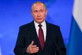 演説するロシアのプーチン大統領=20日、モスクワ(タス=共同)