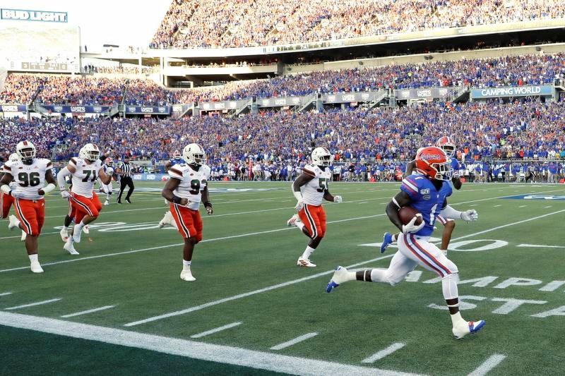 8月24日に行われた開幕戦はフロリダ大がマイアミ大(フロリダ)に24―20で勝った(AP=共同)