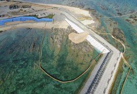 沖縄県名護市辺野古の沿岸部の埋め立て予定区域に投入され積もった土砂=15日午後(小型無人機から)
