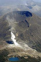 噴気を上げる霧島連山・硫黄山(手前)。中央は韓国岳、奥は活動を続ける新燃岳=20日午後2時3分、えびの市(共同通信社機から)