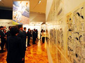 浦沢直樹展の「YAWARA!」コーナー。同展ではネームや下書き、完成原稿と漫画ができる過程を楽しめる=19日、山口市