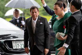 会場に到着したフィリピンのドゥテルテ大統領=22日、東京都内(ロイター=共同)
