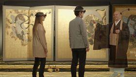 専用のゴーグル型端末を身に着け「風神雷神図屏風」の作品世界を鑑賞体験するイメージ。右の僧侶は3D映像で登場する