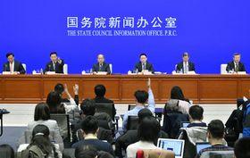 米中貿易協議の進捗状況を説明するため中国政府が開いた記者会見=13日、北京(共同)