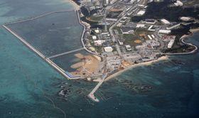 新たな区域(左奥)への土砂投入準備が進む沖縄県名護市辺野古の沿岸部=25日午前10時3分(共同通信社機から)