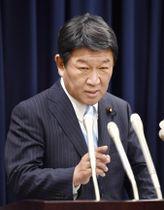 TPP参加11カ国の合意を受け、記者会見する茂木経済再生相=23日午後、東京・永田町