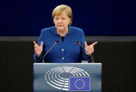 EU欧州議会で演説するドイツのメルケル首相=13日、フランス・ストラスブール(ロイター=共同)