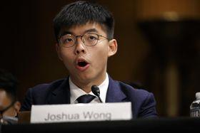 17日、米議会の公聴会で証言する黄之鋒氏=ワシントン(AP=共同)