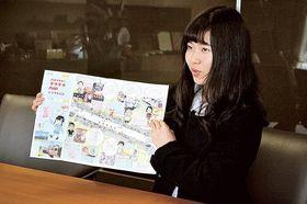 完成したマップを紹介する藤吉さん=富士市役所