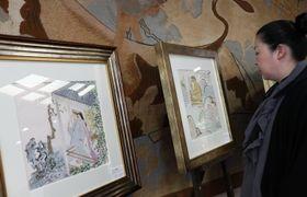 原画や版画などが並ぶ小島功展=長崎市、諏訪神社参集殿