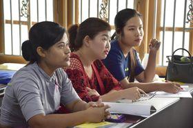 外国人実習生としての派遣を目指し、ヤンゴンの日本語学校で学ぶミャンマーの女性=2018年5月(共同)