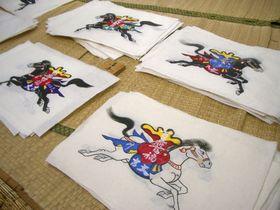絵馬市(8月1日~16日) 和紙に書かれた紙絵馬は、家内安全や商売繁盛などを願う縁起物として親しまれています