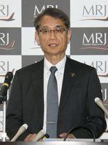 MRJの開発状況について説明する三菱航空機の水谷久和社長=16日午後、名古屋市