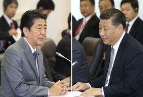 会談する中国の習近平国家主席(右)と安倍首相=9月12日、ロシア・ウラジオストク(代表撮影・共同)