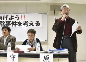 シンポジウムで発言する元北海道警釧路方面本部長の原田宏二さん=22日午後、札幌市