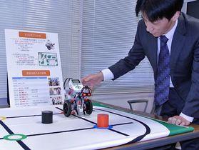 学生たちが開発に携わったロボットの一例。センサーで色を判断し、同じ色の円上まで運ぶ