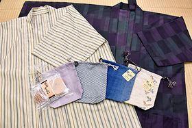 白根沢がドラマチック戎市で試験販売する巾着袋と謙信せんべい、法被
