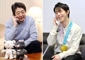 平昌冬季五輪のフィギュアスケート男子で2連覇を果たし、安倍首相(左、代表撮影)から電話で祝福される羽生結弦選手=17日、韓国・平昌(共同)