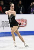 3月の世界選手権で優勝したケイトリン・オズモンドのフリー演技=ミラノ(共同)