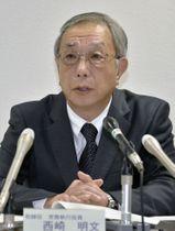 広島高裁の仮処分決定を受けて記者会見する四国電力の西崎明文常務=17日午後、高松市