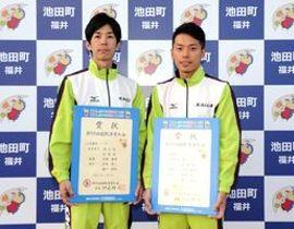 クライミング成年男子リード競技で準優勝した尾﨑晃一(左)・樋口純裕組(テプコシステムズ・クライミングジムPUMP2)=福井県の池田町特設会場