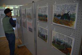迫力ある絵と文章で旧満州での戦闘を伝える記録画(野洲図書館)