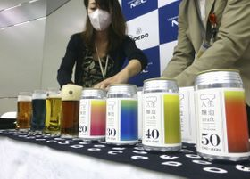 NECと協同商事が共同開発したビール「人生醸造クラフト」=15日、東京都内