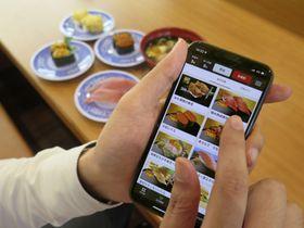くら寿司が始めたアプリで事前注文できるスマートフォンの画面=16日、大阪市