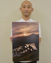 【会場に展示している熊野市内の風景を撮影した写真=熊野市役所で】