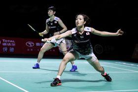 10日の福州中国オープン決勝でプレーする福島(右)広田組=福州(ゲッティ=共同)