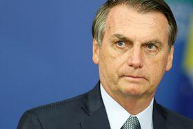 ブラジルの首都ブラジリアでの式典に出席するボルソナロ大統領=21日(ロイター=共同)