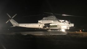 沖縄県渡名喜村・渡名喜島の村営ヘリポートに着陸した米軍のAH1攻撃ヘリコプター=23日午後10時ごろ(住民提供)