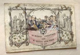 ロンドンのチャールズ・ディケンズ博物館に展示された、世界初とされるクリスマスカード(英PA通信=共同)
