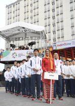 ジャカルタ・アジア大会の選手村入村式に臨む日本選手団=16日、ジャカルタ(共同)