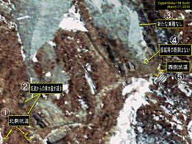 3月17日に撮影された北朝鮮・豊渓里の核実験場の衛星写真。(1)が北側坑道で(5)が西側坑道(デジタルグローブ/38ノース提供・ゲッティ=共同)