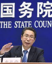 記者会見する中国国家知的財産権局の申長雨局長=24日、北京(共同)