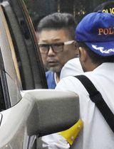 逮捕された浅野勉容疑者=18日午前6時30分、愛知県知多市